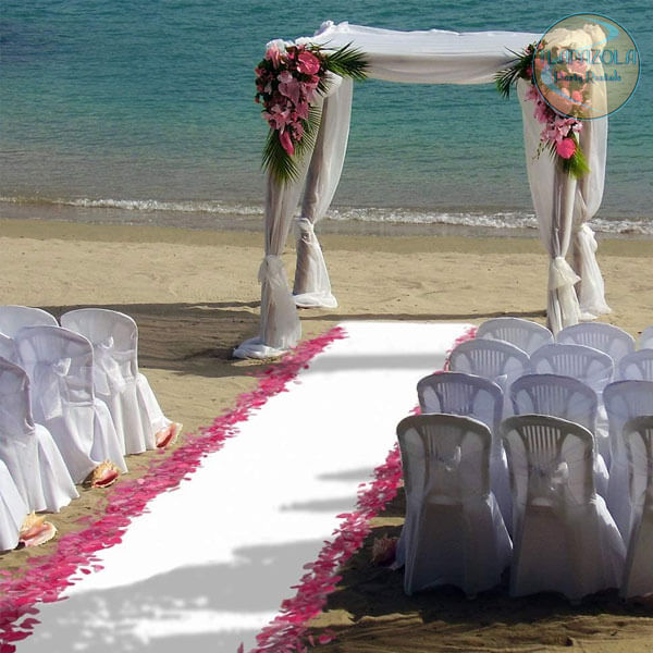 white carpet being used in a wedding at the beach